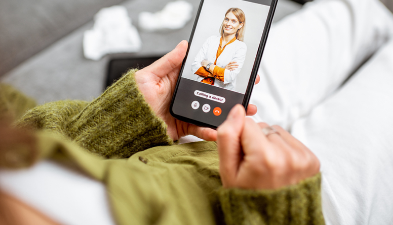 healthinsurance.com telemedicine 101, patient video chatting with doctor on a smartphone